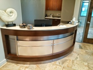 Radius reception desk brown wood stainless steel by hmcwoodwork.com